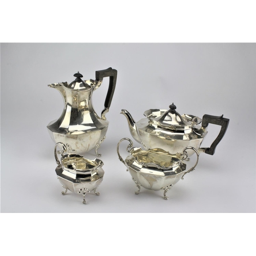 36 - An English silver four piece tea set, decorated with cast Chippendale boarder, resting on volute fee...