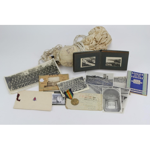 309 - A Collection of Military Police Second World War Medal, Postcards and a Folding Camp Bed....