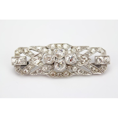 66 - A Beautiful 1930's Diamond and Platinum Set Brooch Set with Four Diamonds in a Collar Setting with F...