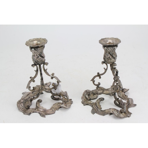 5 - A Beautiful Pair of Irish Silver Rococo Design Candlesticks Cast with Floriat Scrolled Borders and S...