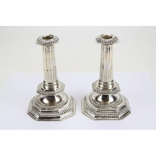 7 - A Pair of Victorian Silver Restoration Designed Gadrooned Stepped Candlesticks resting on Octagonal ...