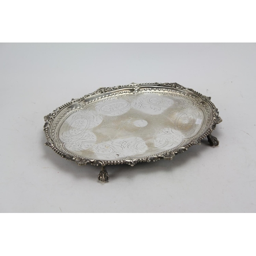11 - A Large Victorian Oval Silver Waiter with Cast Silver Border Husk and Bead Decoration. Weight: 1,600...