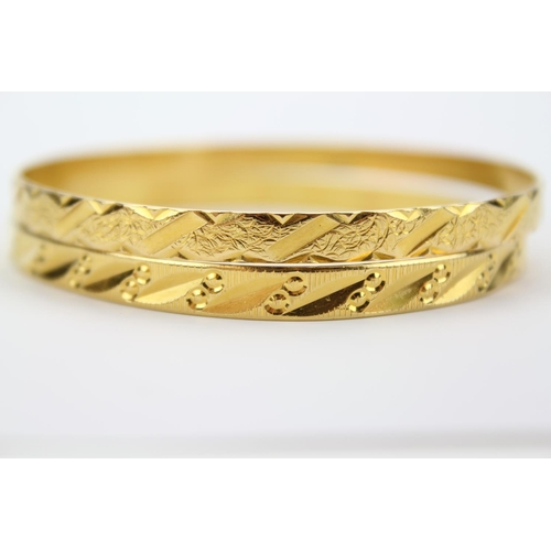 88 - A Ladies 21ct Gold Bangle Decorated with Flowers along with one other decorated Similarly. Marked M....