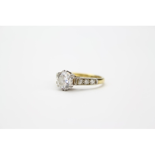 118 - A Ladies Single Stone Diamond Ring, Mounted in Gold with Platinum And Diamond shoulders. Weight: 3.3...