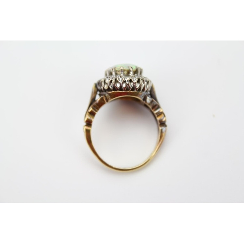 119 - A Lovely Ladies 18ct Gold Dress Ring, Mounted with an Opal & surrounded with Diamonds. Weight: 7.7, ...