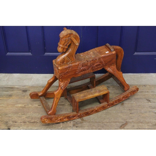 1 - A Carved Hardwood Rocking Horse, Box Shaped and Raised head, made with elongated tail, two lift-up s...