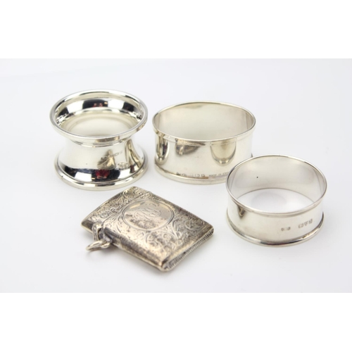 34 - A Silver engraved Vesta Case and three silver napkin rings. Total:  71 grams.