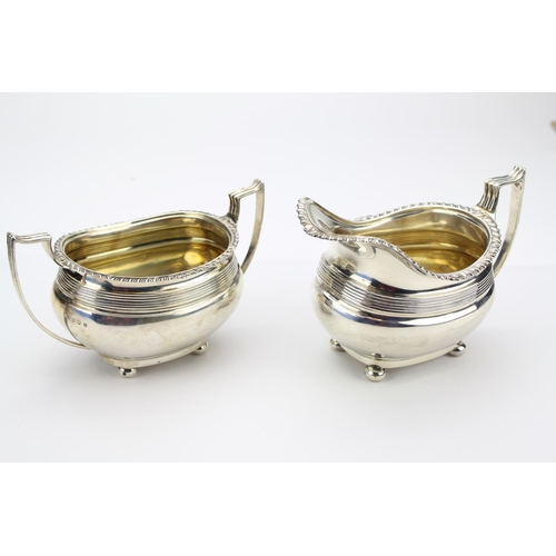 39 - A Georgian designed gadrooned edge Silver Cream Jug and Sugar Bowl with Reeded Handles,