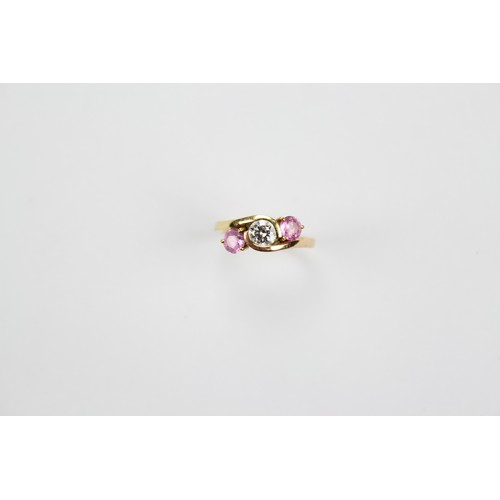 39 - A Ladies Diamond & Crossover Ring set in a Gold Mount in Original Box. Size: L....