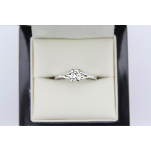 38 - A Ladies 18ct White Gold set dress ring. Approx: 0.5cts. Size: R/S....