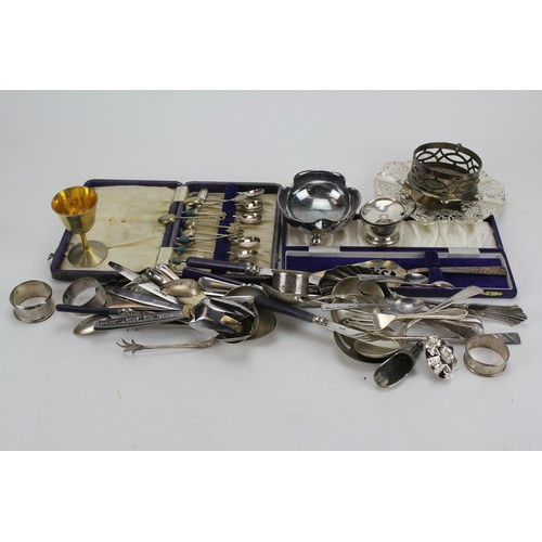 16 - A collection of Silver napkin rings, sugar tongs, Chinese Silver colour white metal spoons, etc....