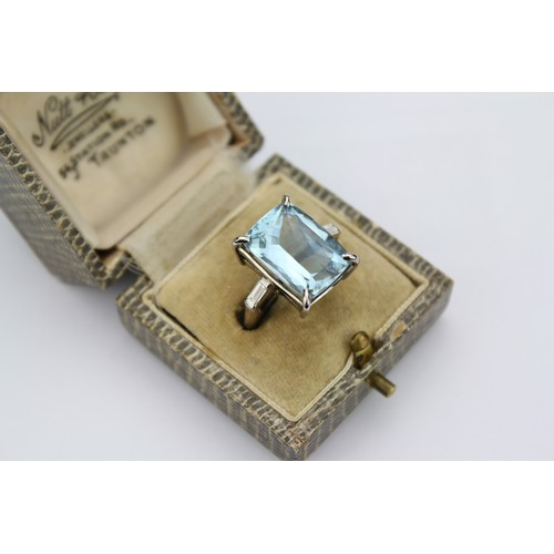 36 - A Beautiful Art Deco Emerald Cut Aquamarine Ring along with two Baguette Diamonds, which are set on ...