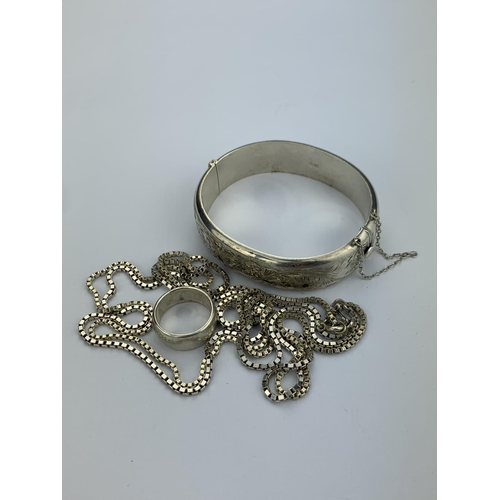 44 - Two Ox link Chains, a Wedding Ring, a Silver Bangle, Butterfly Fairy Brooch, etc....