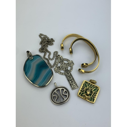 45 - A 1960's Silver Free Form Pendant, a Celtic Cross, a Plated Bangle, Agate Pendant and a Green Stone ...
