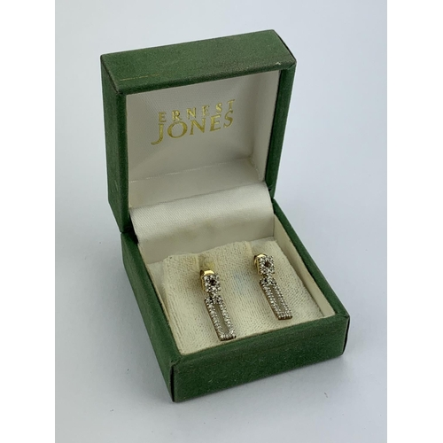 32 - A Pair of Diamond and Gold Set Rectangular Earrings in Original Box....
