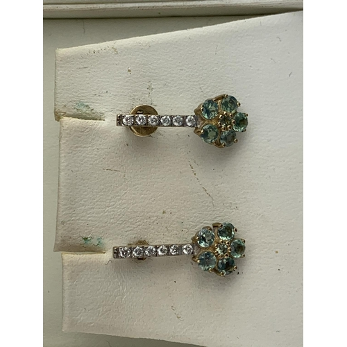 33 - A Pair of Ladies Diamond Floral Cluster and Peridot Earrings in Original Box....