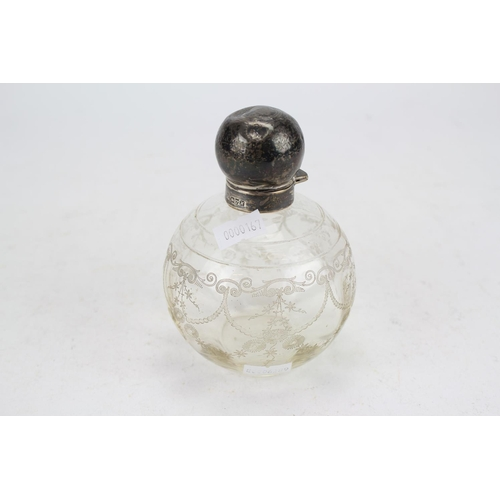 15 - A Silver Topped Cologne Bottle with a Stopper....
