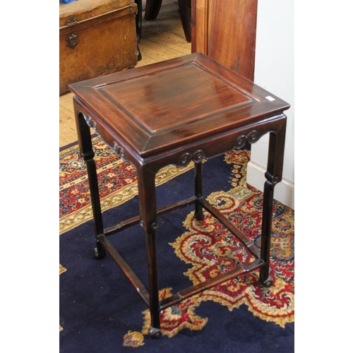 126 - A Chinese Hardwood Side Table with Carved Side Supports, Offset Legs and Stylized Feet. Measuring: 1...