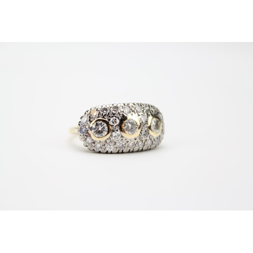 47 - A Ladies Gold Set Diamond Cluster Ring Mounted with Three Central Diamonds and surrounded by Small C...