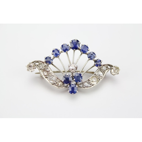 48 - A Ladies Diamond Set Spray Brooch Decorated with a Cluster of Sapphires over a Swag of Diamonds....