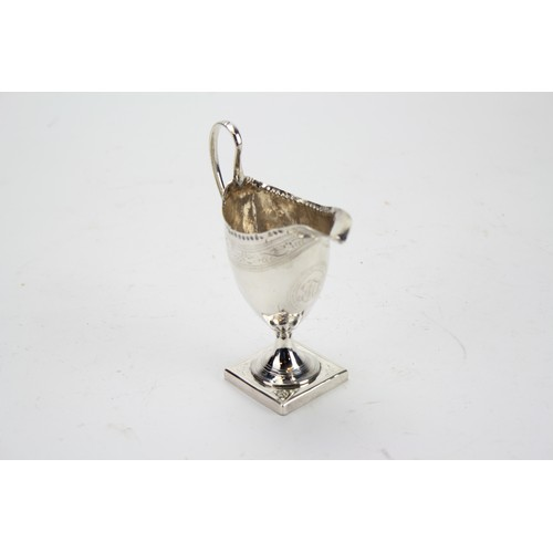 7 - A Georgian Silver Helmet Shaped Cream Jug Resting on Square Base, Bright Cut Base and Engraved....