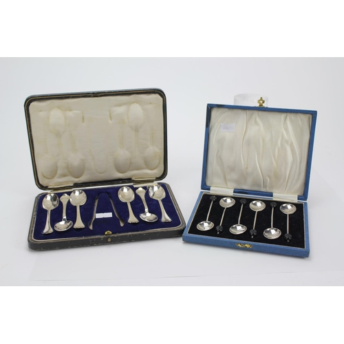 2 - A set of six Silver Trifid handled tea spoons in a leather case and a set of Six bean handled coffee...