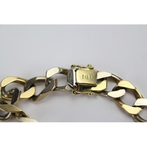 94 - A Gentleman's 18ct Gold Curb Link Bracelet with Safety Clasp. 41.26grams....