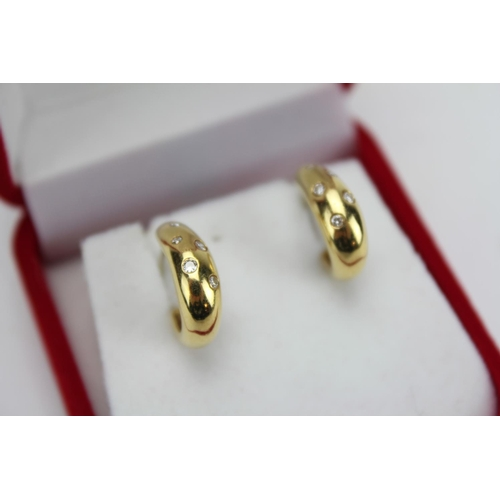 97 - A Pair of 18ct Gold Diamond set crescent moon earrings. PS 90....