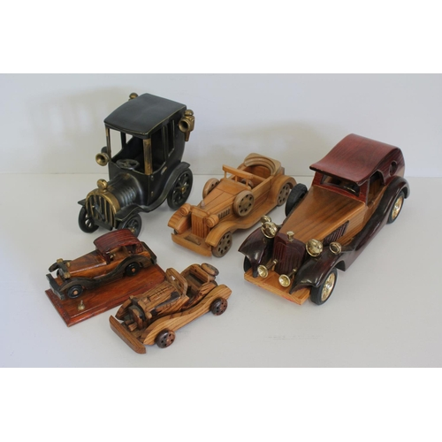 326 - A Collection of 5 model cars to include 4 in Wood & 1 in Cast Iron.