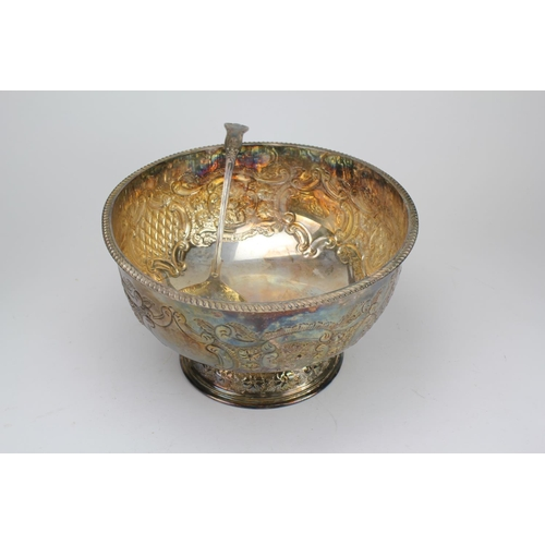 24 - A Large Silver Plated Punch Bowl complete with the Original Ladle. Measuring: 33 cms across x 19 cms...