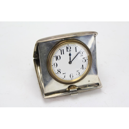 123 - A Silver Swiss made Travel Clock in a Silver Case. (Total Weight including mechanism: 332g.)...
