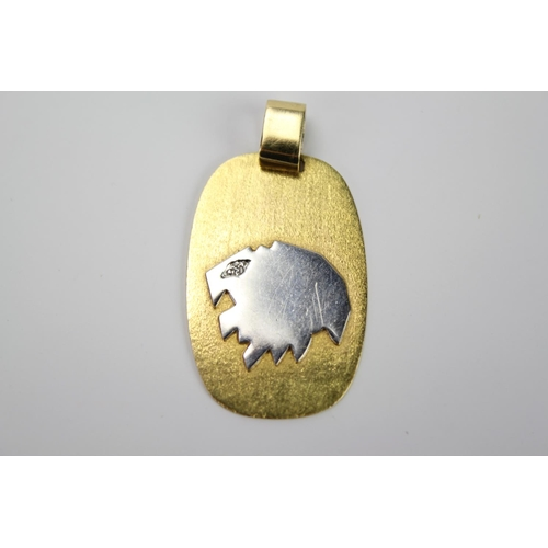 54 - An 18ct Gold Pendant with Silver decoration set with a small chip Diamond. Weighing 6.7g. (Total Wei...