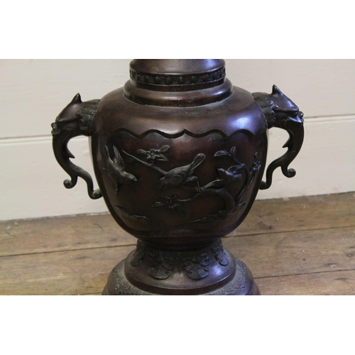 127 - A Large Japanese Bronze Vase with stylised Elephant handles, with a flared diaper work rim & swept o...