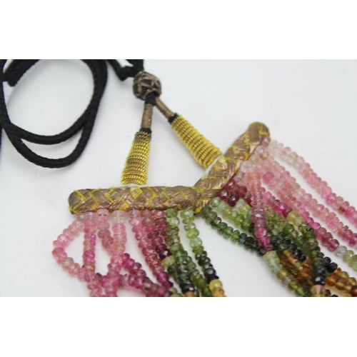 69 - An Indian string necklace of various Gem Stones on a black cord....