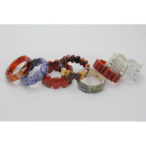 73 - A Collection of Hardstone Bangles, Agate, Mop, etc....