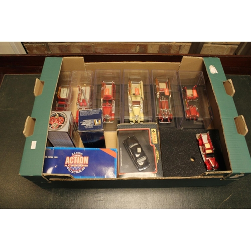 337 - A Collection of 11 mostly boxed models to include: Fire Engines, Cars, etc. Makers to include: Eagle...