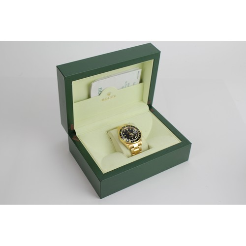103 - A Rolex GMT-Master II in 18k Yellow Gold, Oyster Perpetual, Gents Wristwatch. Black dial with date a...