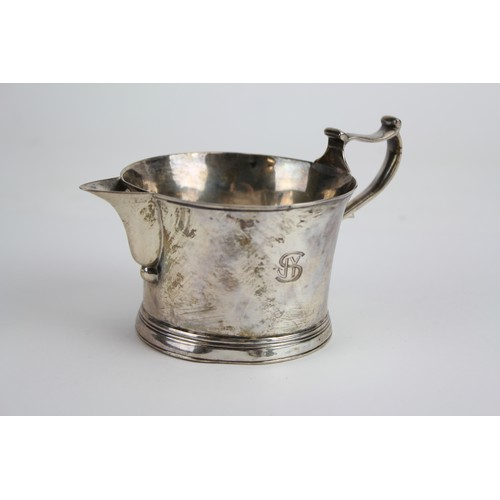 80 - A Silver Cream Jug with engraved decoration. Weighing 145g.
