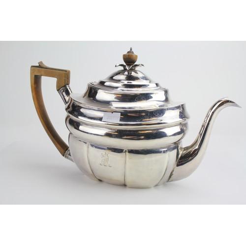 81 - A Peter & William Bateman Georgian Silver Oval Tea Pot with Crest . Weighing: 601g.
