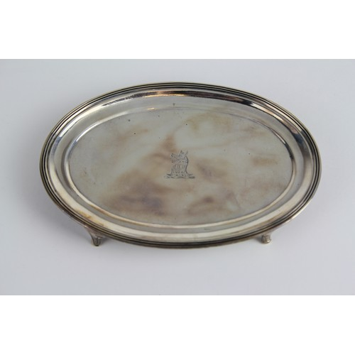 82 - A Rebecca Emes & Edward Barnard Oval Silver Tea Pot Stand with engraved Crest. Weighing: 103g.