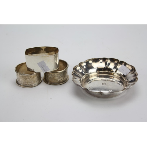 46 - A Silver 1953 Bon Bon Dish and 3 x Silver Napkin Rings. Weighing: 153g....