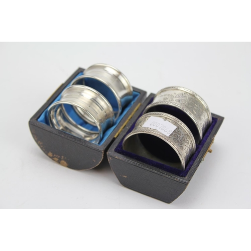 38 - A Pair of Victorian Silver engraved Napkin Rings in Original Case. Chester d. Along with one other p...