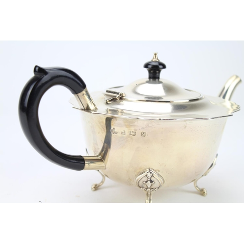 18 - A 1920's Chippendale bordered Silver Tea Pot resting on Pad Feet by Frederick Elkington & Company. B...