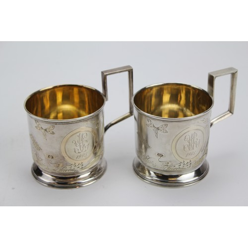 23 - A Collection of Russian Silver to include a Pair of Silver & Frosted Art Nouveau engraved Tea Glass ...