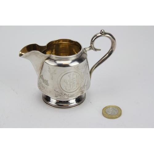 40 - A Russian Silver Art Nouveau Cream Jug. Marked 84. Maker: UUN. Weighing: 127g....