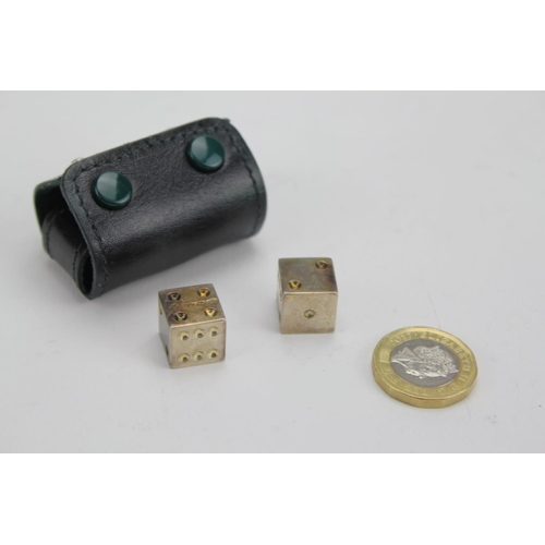 34 - A Pair of Silver Dice in Original Case, Marked 925. A.E.Jones, London 2000. Weighing: 40g....