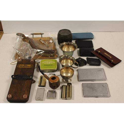 257 - A Collection to include: Ronson Lighters, Evan Patent Cigarette Rolling Machine, Pipe, etc....