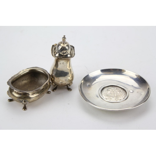 29 - A Maria Theresa Thaler mounted in a pin dish along with a Silver pepper and mustard....