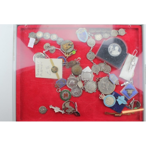 259 - A Collection to include: Silver 3d bracelets, RAF, Ping Pong, Snooker, etc....