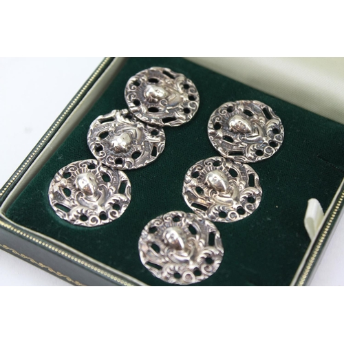 43 - A set of 6 Silver cast buttons, ladies head in Case....